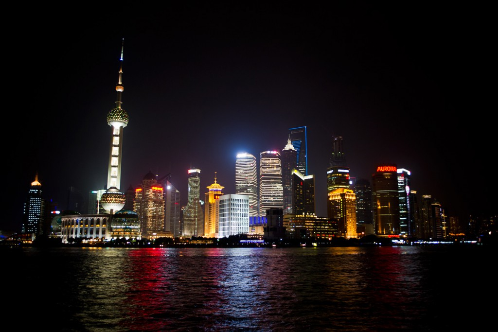 Huangpu River and Pudong skyline at night. By day, gulls can be found on the river.
