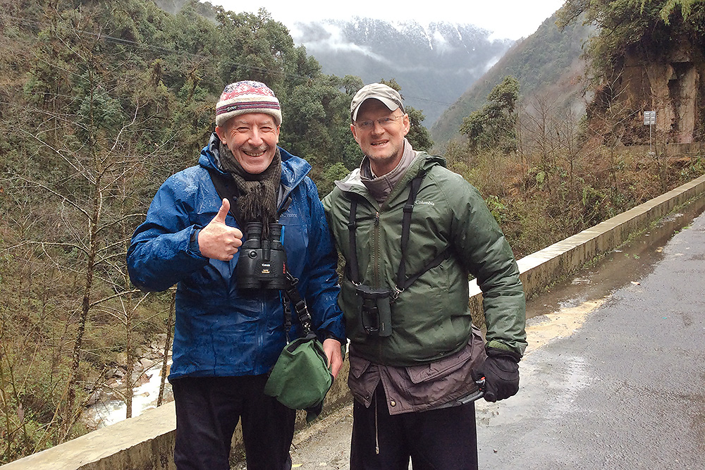 Brian Ivon Jones (L) and Craig Brelsford celebrating after finding Golden-naped Finch, on bridge below Sibia Lane, 23 Feb. 2016. Photo by Elaine Du.