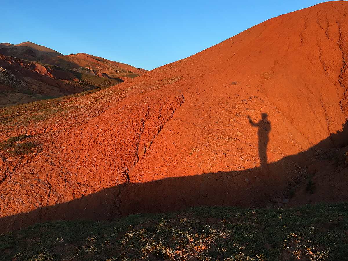 Craig Brelsford, Selfie in Shadow Against Ochre Hillside, near Suli, 6 Aug. 2016.