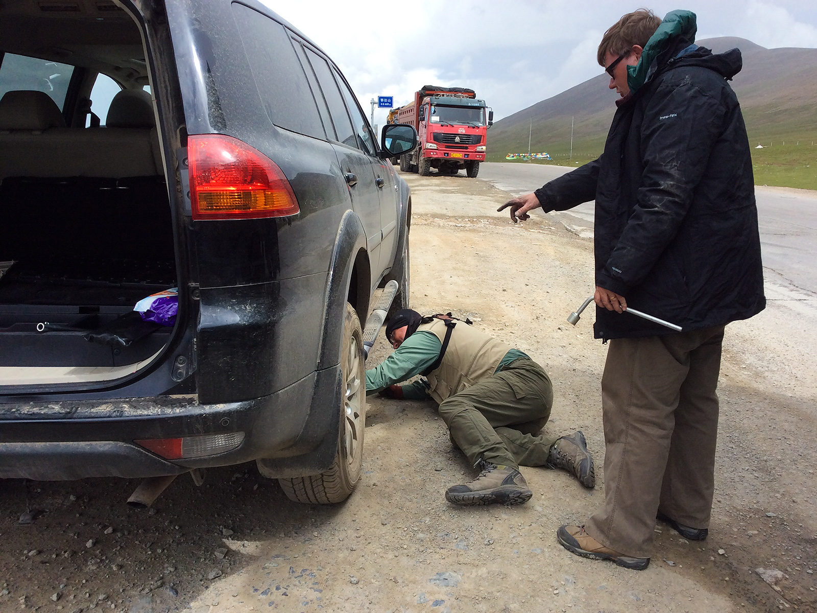 On 2 July at Ela Pass we changed a flat tire. (Craig Brelsford)