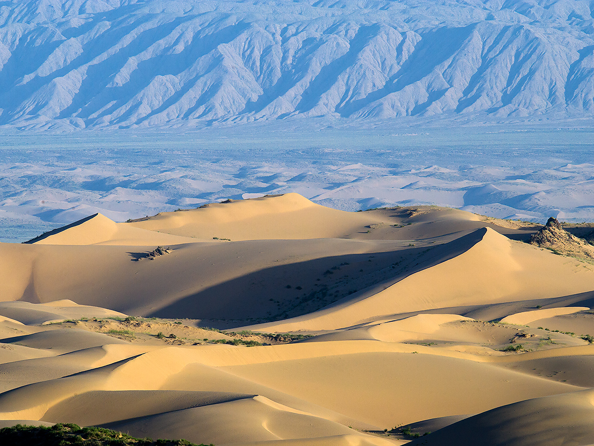 Dunes and mountains, Wulan County, Qinghai, 17 Aug. 2016. This photo was taken at 36.826334, 97.965649, elev. 3380 m.