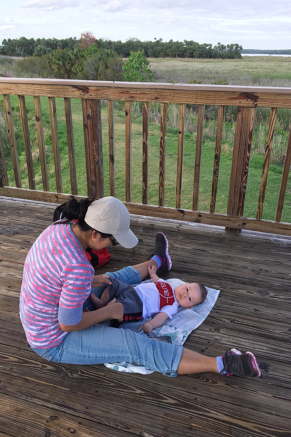 Elaine and Tiny in the observation tower at Lake Woodruff National Wildlife Refuge. The top eBird hot spot in Volusia County, Woodruff is known as a breeding site of Swallow-tailed Kite. Sandhill Crane also breed here, and Bald Eagle are regularly noted. (Craig Brelsford)