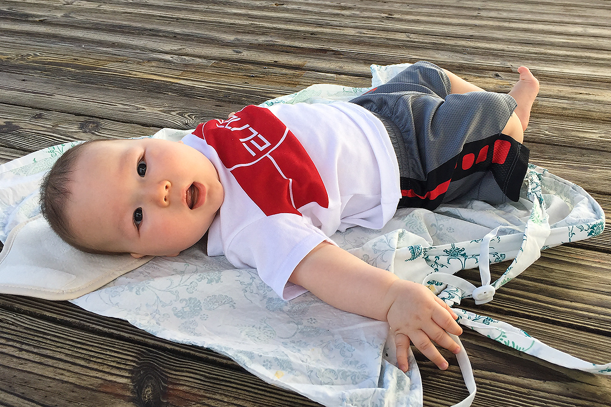 Our four-month-old baby boy at Woodruff. A human baby is a natural phenomenon and a thing of beauty--beautiful in the way a sunset or waterfall is beautiful. I got into birding because my eyes hungered for natural beauty. Now, my son satisfies some of that longing. (Elaine Du)