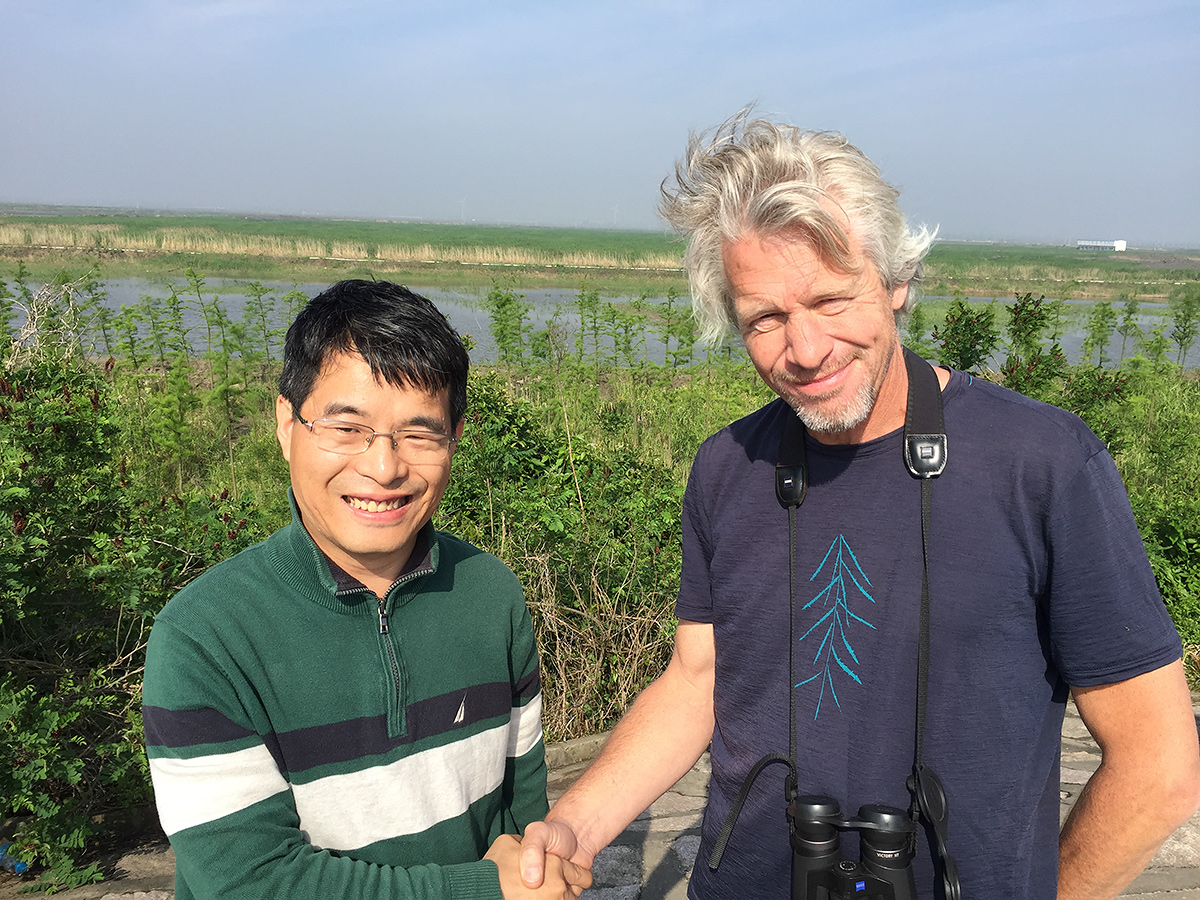 Mike May (R) and Zhāng Dōngshēng (张东升) meet. Dōngshēng, a professor at Shanghai Ocean University, is leading an effort to conserve Cape Nanhui.