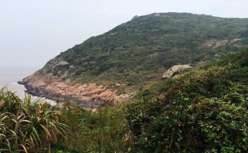 Rock, sea, and hills covered with original Sijiao scrub.