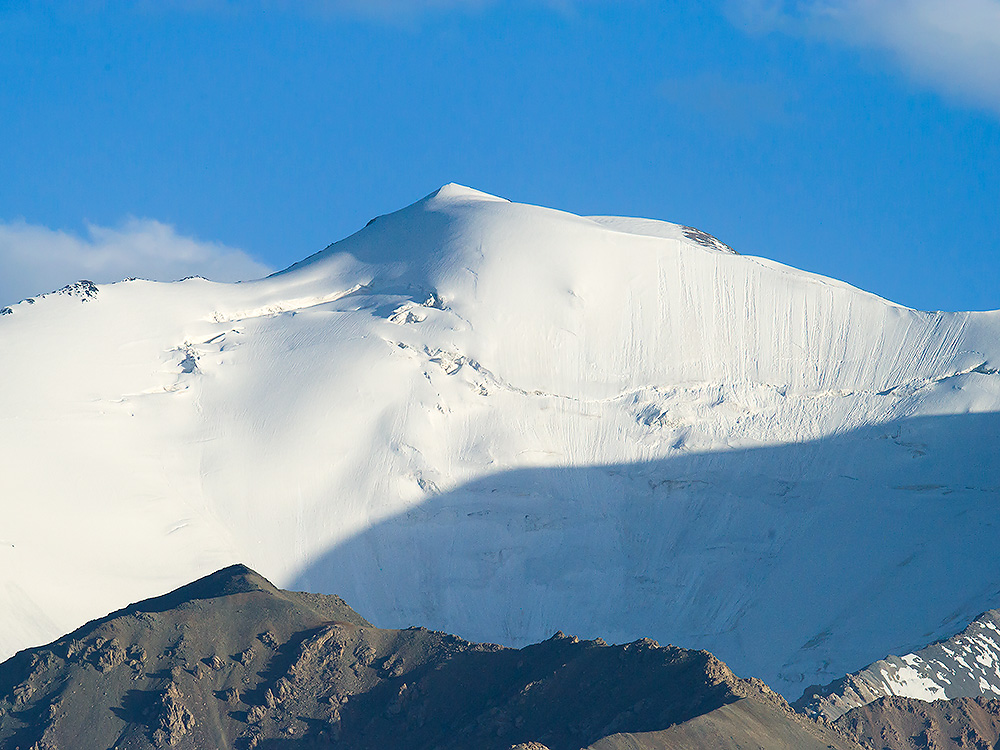 Snow-capped peak in Qilian Mountains, near Subei, Gansu. Photo taken from elev. 3190 m. 24 July 2014.
