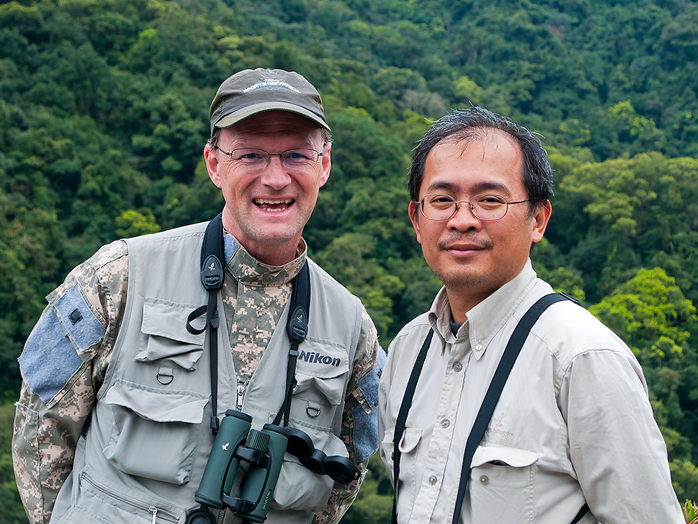 Craig Brelsford and Wú Chóng Hàn, Wulai, Taiwan, 17 Feb. 2013. I can sum up the performance of my personal guide in one sentence: Wú Chóng Hàn shares your passion for birding!