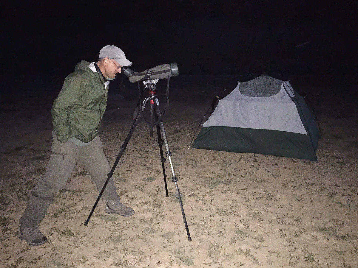 Craig Brelsford studies the planets through his spotting scope at camp on 8 Aug. 2016.