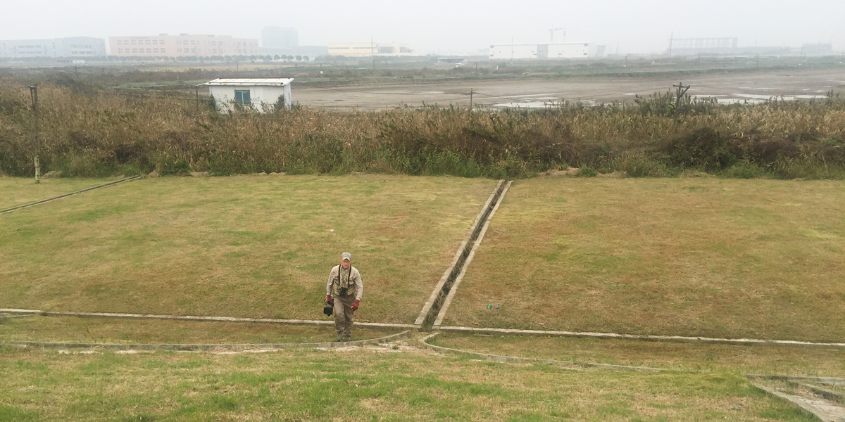 Craig Brelsford leaves walks up the inner base of the sea wall near Luchao, 10 Nov. 2016.