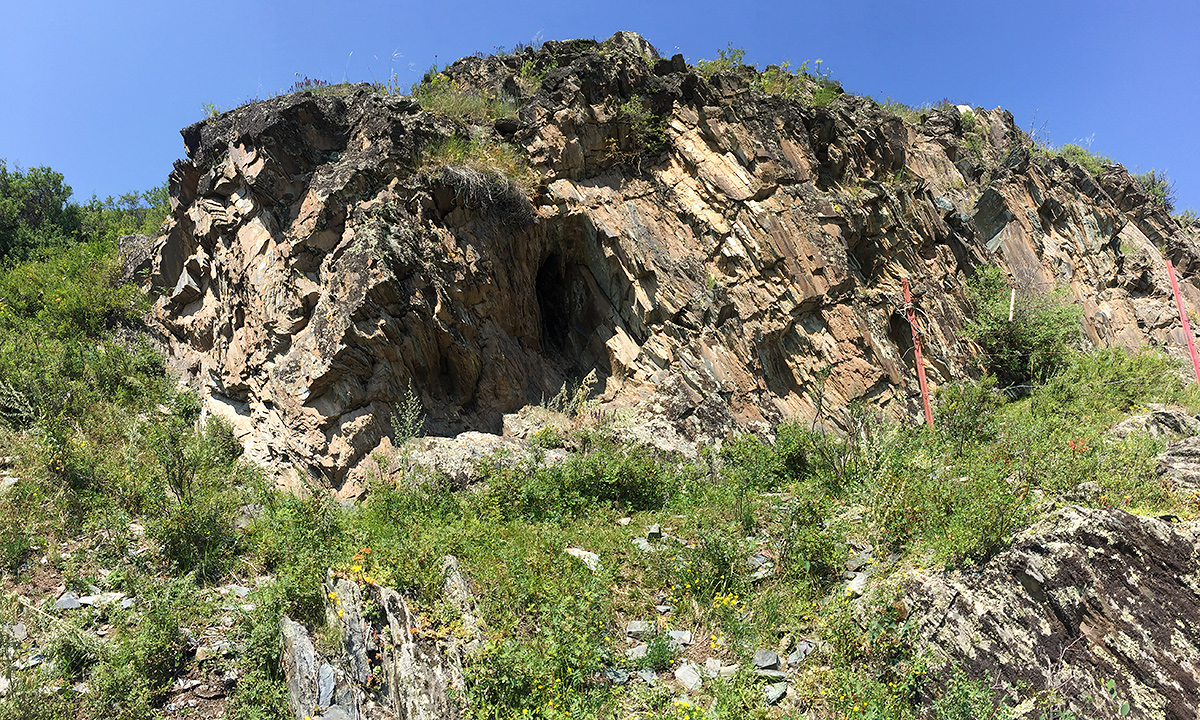Rocky outcrop near Kanasi River, 27 July 2017. This outcrop is the home of a most unusual leaf warbler, the wallcreeper-like Sulphur-bellied Warbler Phylloscopus griseolus. Also in the vicinity was a family of Common Rock Thrush Monticola saxatilis. Coordinates: . Elev.: 1420 m (4,660 ft.). (Craig Brelsford)