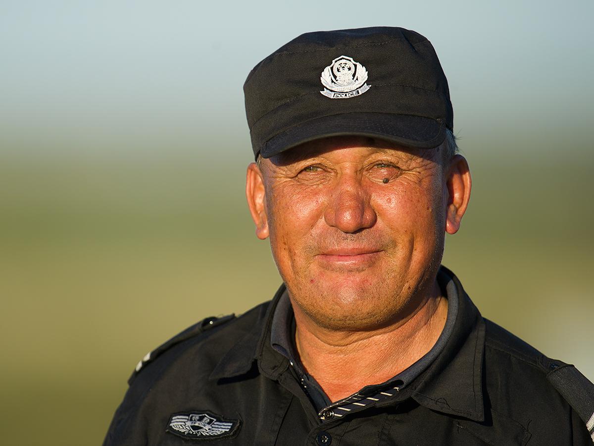 Ethnic Kazakh police officer. Burqin, Xinjiang, 25 July 2017. (Craig Brelsford)