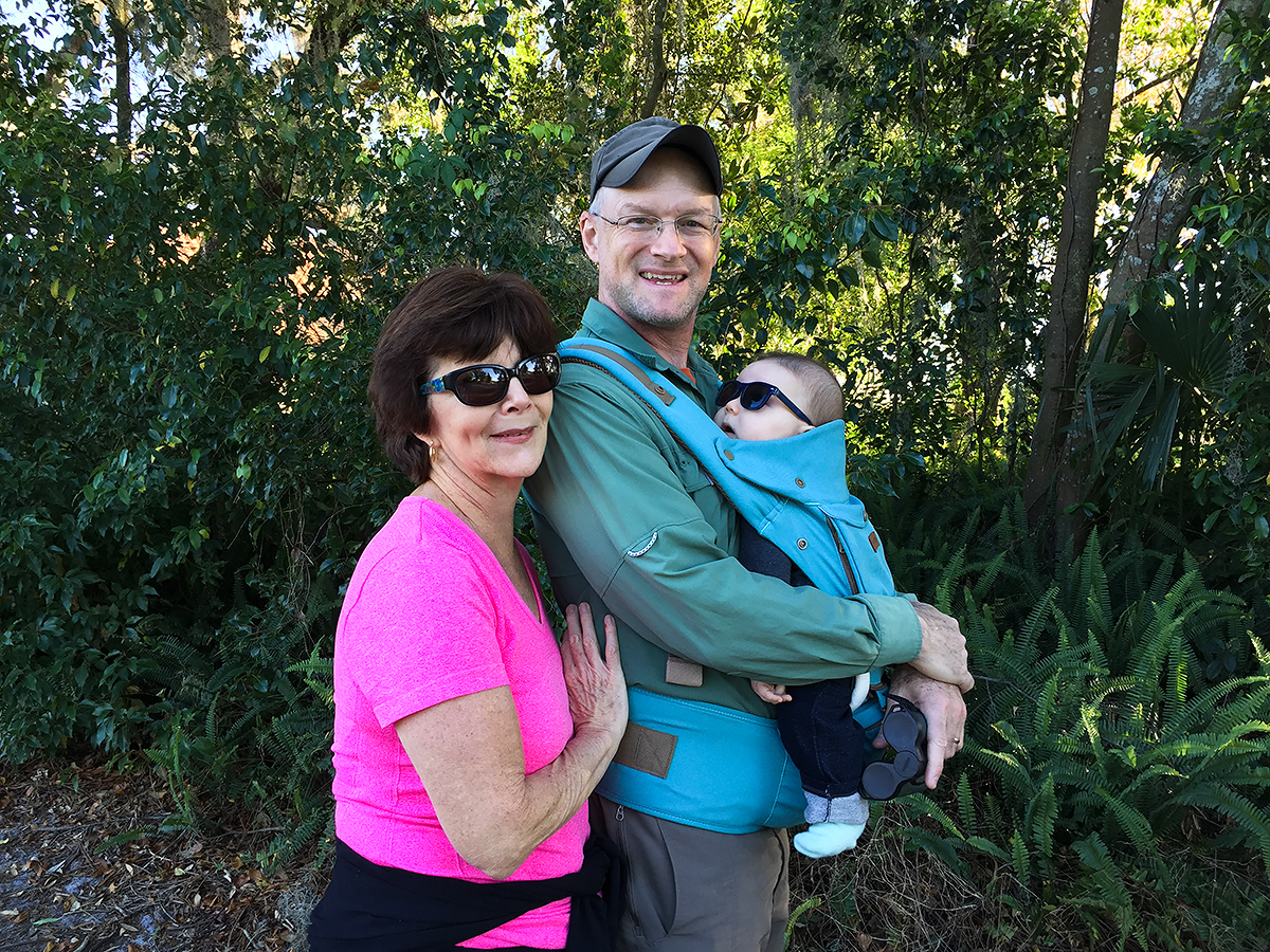 My mother (L) is ecstatic over the return of her son and arrival of her newest grandson. I told her, 'This time you got me. I'll never live abroad again.' With Tiny in tow, we were birding 3 March 2018 near my parents' house in Debary, Florida. (Elaine Du)