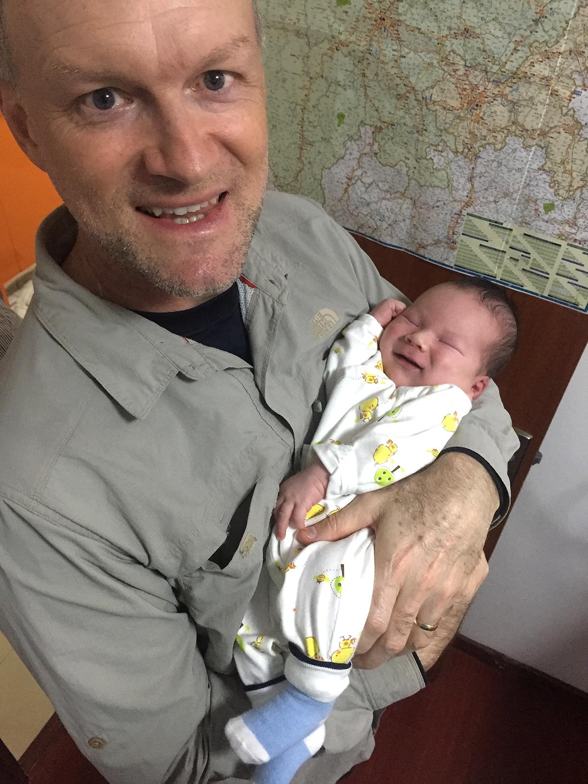 Craig Eugene Brelsford holding his baby son, Craig Eugene Brelsford II. (Elaine Du)